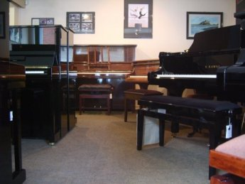 Inside Carstairs Pianos, Roper Road showroom.