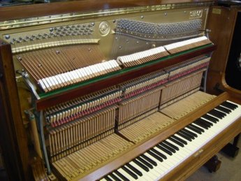 A restored 1920's Steck upright piano.